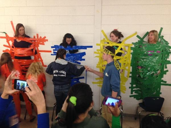 For the Spirit Week Lunch Game on Thursday for Kingdom Day, students bought Tape to tape a teacher to the wall