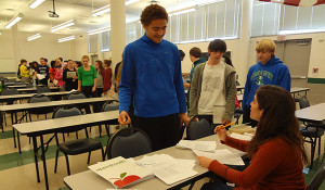 Speech/debate tournament, mock testing and theater set building make for busy Saturday