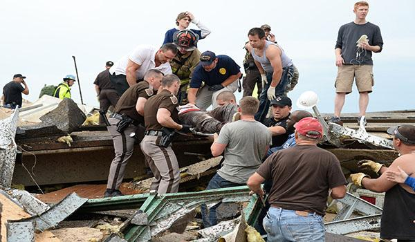 An injured person is removed from the rubble in the aftermath of a huge tornado that struck Moore, Oklahoma, Monday, May 20, 2013. At least 51 people were killed, including at least 20 children, and those numbers were expected to climb, officials said Tuesday. (Gene Blevins/Zuma Press/MCT)