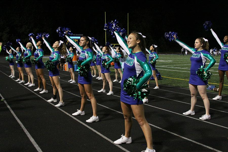 Varsity+cheerleading+performs+at+the+first+home+game+against+Westfield+on+Sept.+6