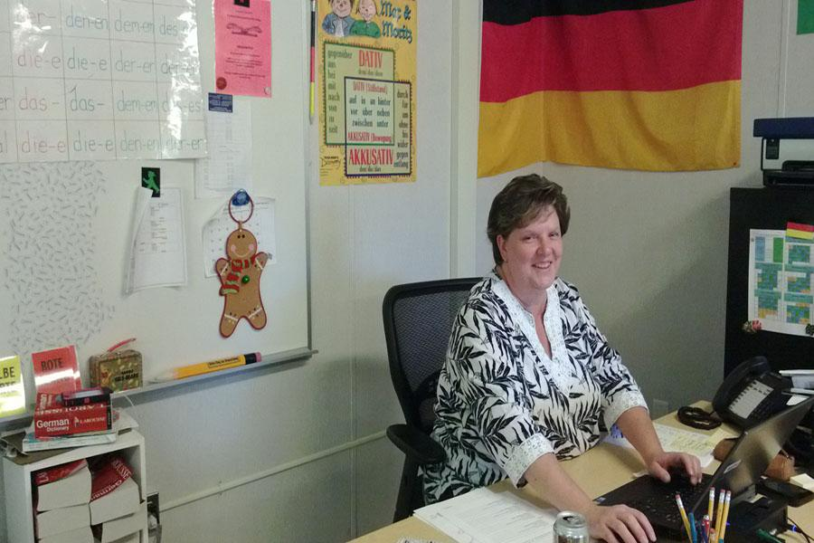 German+teacher+Cheryl+Finley+sits+at+her+desk+during+her+8th+period+class.