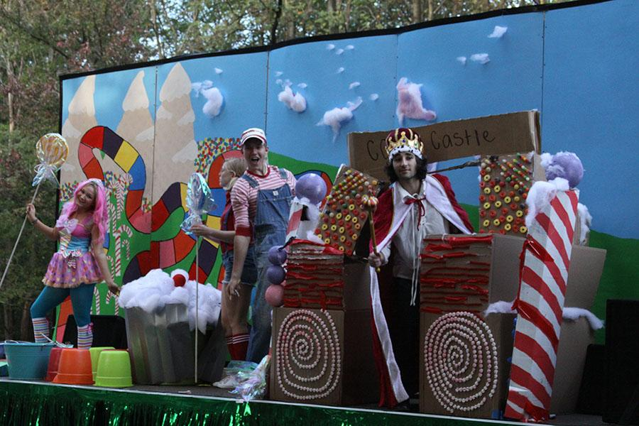 Seniors Allison Scheler, Josh Brust, and Sammy Nazam ride in the homecoming parade on Class of 2014s Candyland themed float.
