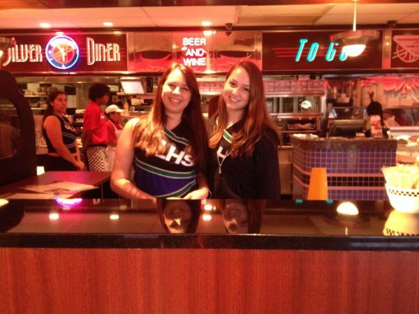 Dance team members play hostess at Silver Diner during a team fundraiser.