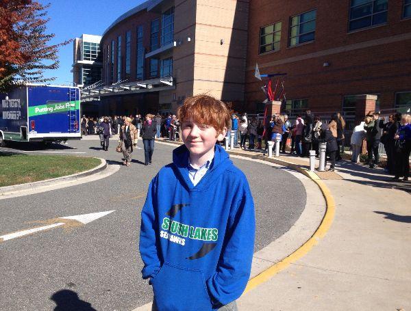 Future Seahawk Aidan Kropp-Sullivan waits outside of Washington-Lee High School for Virginia gubernatorial candidate Terry McAuliffes rally.