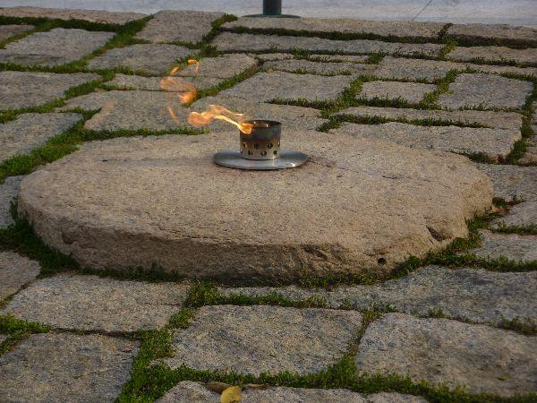 The John F. Kennedy Eternal Flame burns on at the presidential memorial at the gravesite of U.S. President John F. Kennedy, in Arlington National Cemetery.