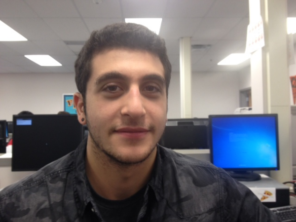 Senior Logan Nasr displays his facial hair on the fourteenth day of No Shave November.