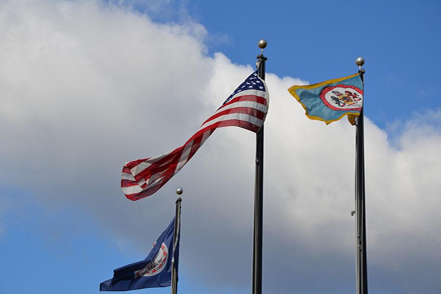 Seahawks+honor+alumus+Naval+Commander+Halle+Dunn+in+flag+raising+ceremony