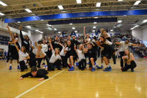 Dance team members and male basketball players strike a pose after their joint performance during the winter pep rally.