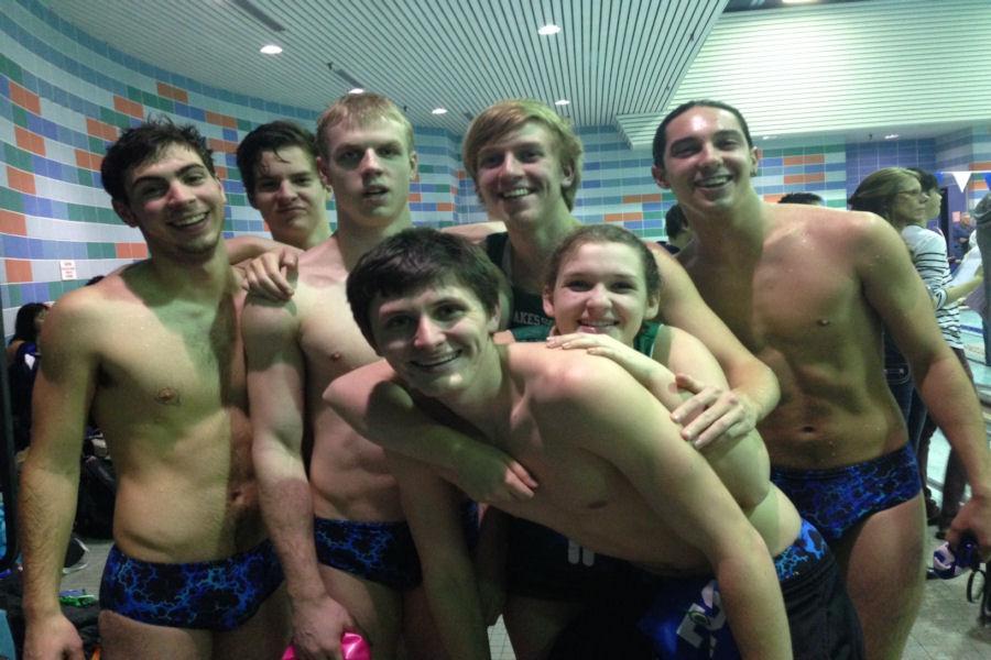 Senior swimmers (from left to right: Matt Hutchins, Greg Blanpied, Tyler Hutson, Ben Gallagher, Mark Lawson, Mel Anderson, and Jerrett Gulakowski) pose during their final home swim meet.