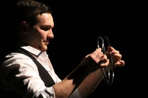 Alum Derek Jasper (Wahdan) during his second to last magic trick during his one-man Show on Feb. 7
