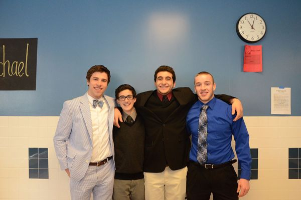(Left to right) Senior ice hockey players Carter Schultz, Sam Polzin, Logan Nasr, and Joey Owens dressed formally for their rivalry game tonight against Herndon.
