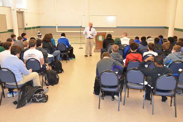 New head football coach Trey Taylor speaks before football players at an introductory meeting March 21. Taylor replaces Marvin Wooten, who stepped down as head of the football program in March to complete the last phase of his Master's degree.