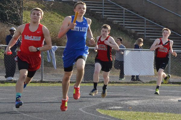 Freshman Ashton Reinhold runs in the 4x800 meter relay at the junior varsity meet on April 2. South Lakes hosted Madison, McLean, and TJ.
