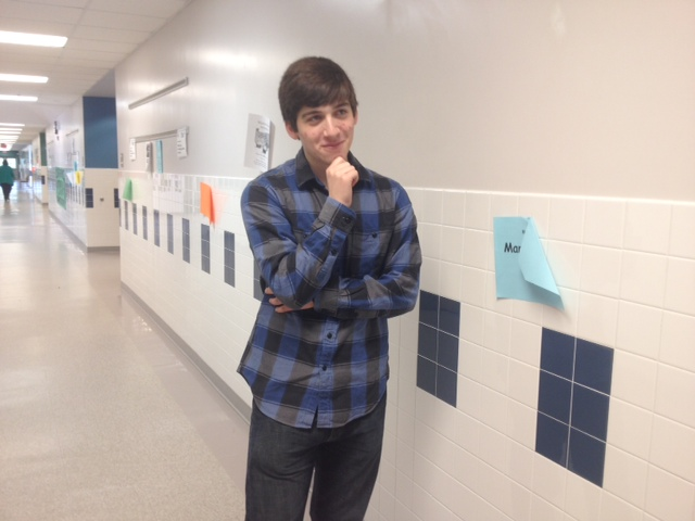 Philosophy Club founder Julian Levy-Myers assumes The Thinker pose.