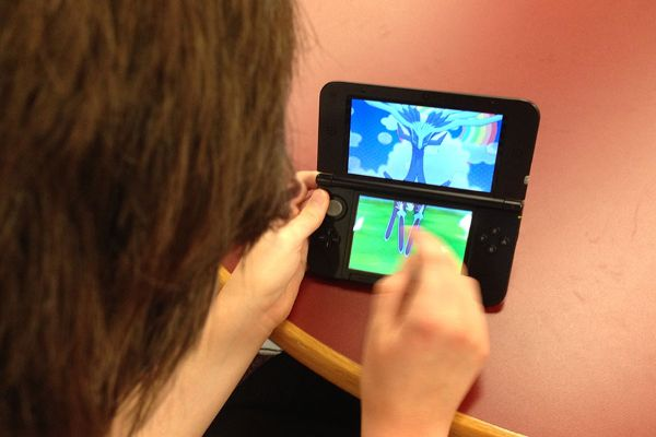 Junior Samantha Sedgwick plays Pokémon X and Y in the Library. The new Pokémon Omega Ruby and Alpha Sapphire will come out in November.