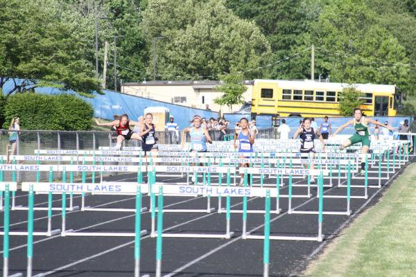 Outdoor track members competed in a hurdle meet last year.