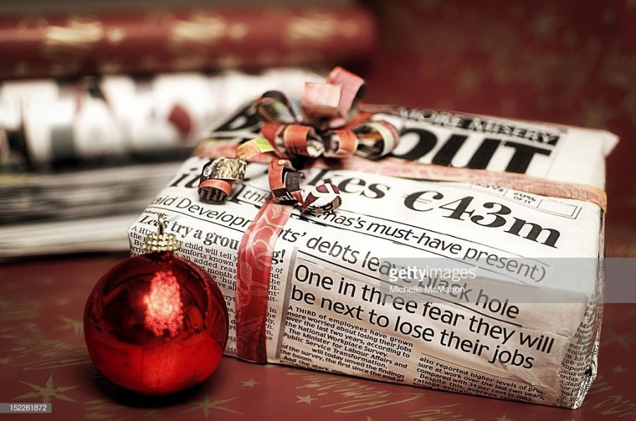 Christmas gift wrapped in newspaper.