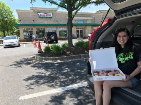 "Editor-in-Chief and senior Leana Travis with her ""Grad Dozen"" doughnuts (courtesy of Leana Travis)"