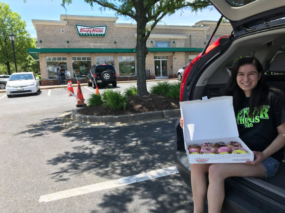 Editor-in-Chief and senior Leana Travis with her Grad Dozen doughnuts (courtesy of Leana Travis)