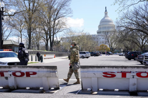 Troops stand guard after a car that crashed into a barrier on Capitol Hill in Washington, Friday, April 2, 2021. (AP Photo/Jacquelyn Martin)